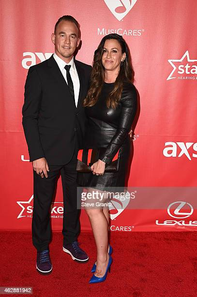 Recording artists Mario Treadway and Alanis Morissette attend the 25th anniversary MusiCares 2015 Person Of The Year Gala honoring Bob Dylan at the...
