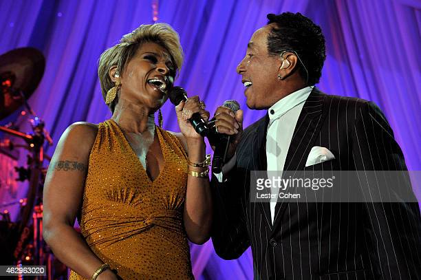 Recording artists Mary J Blige and Smokey Robinson perform onstage at the PreGRAMMY Gala and Salute To Industry Icons honoring Martin Bandier at The...