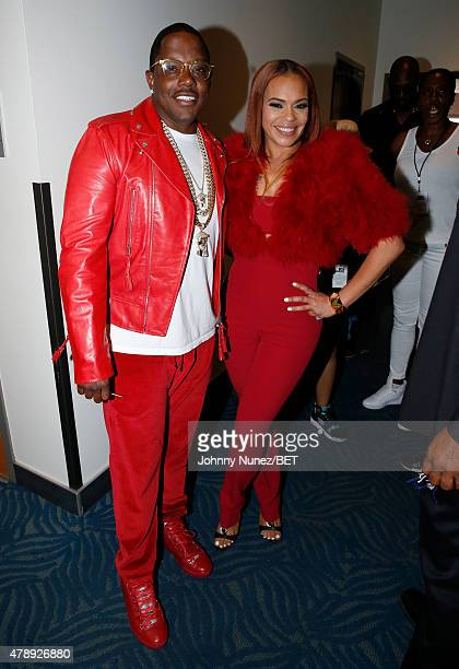 Recording artists Mase and Faith Evans pose backstage during the 2015 BET Awards at the Microsoft Theater on June 28 2015 in Los Angeles California