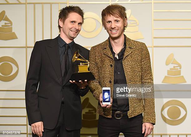 Recording artists Matt Bellamy and Dominic Howard of music group Muse winners of Best Rock Album for 'Drones' pose in the press room during The 58th...