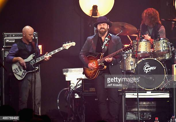 Recording artists Matt Mangano Zac Brown and Chris Fryar of the Zac Brown Band perform onstage during the 2014 iHeartRadio Music Festival at the MGM...