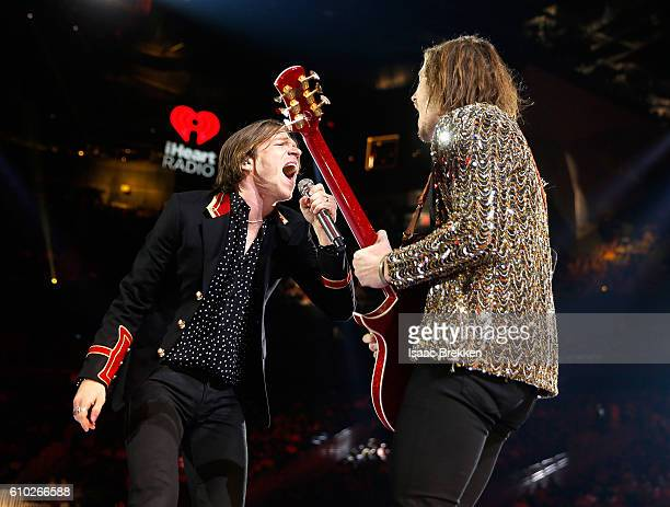 Recording artists Matt Shultz and touring guitarist Nick Bockrath of music group Cage the Elephant perform onstage at the 2016 iHeartRadio Music...