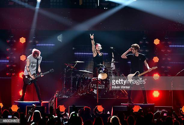 Recording artists Michael Clifford Ashton Irwin and Luke Hemmings of music group 5 Seconds of Summer perform onstage during KIIS FM's Jingle Ball...