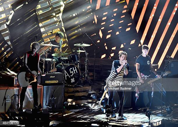 Recording artists Michael Clifford, Ashton Irwin, Luke Hemmings, and Calum Hood of 5 Seconds of Summer perform onstage during the 2014 MTV Video...