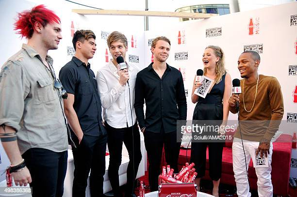 Recording artists Michael Clifford Calum Hood Luke Hemmings and Ashton Irwin of music group 5 Seconds Of Summer and TV personality Poppy Jamie and...