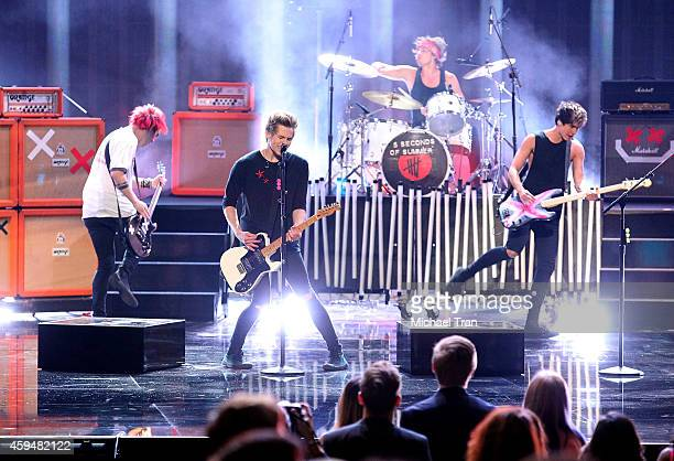 Recording artists Michael Clifford, Luke Hemmings, Ashton Irwin and Calum Hood of 5 Seconds of Summer perform onstage performs/speaks onstage during...