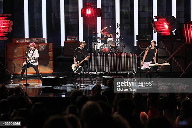 Recording artists Michael Clifford, Luke Hemmings, Ashton Irwin and Calum Hood of 5 Seconds of Summer perform onstage during the 2014 American Music...