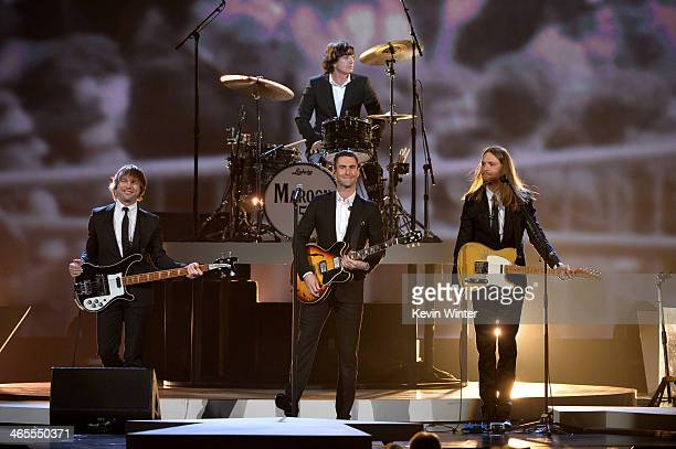 Recording artists Mickey Madden Adam Levine Matt Flynn and James Valentine of Maroon 5 perform onstage during The Night That Changed America A GRAMMY...