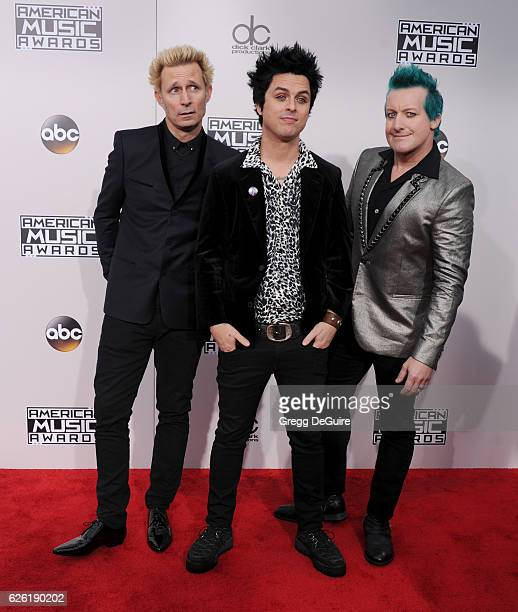 Recording artists Mike Dirnt Billie Joe Armstrong and Tre Cool of Green Day arrive at the 2016 American Music Awards at Microsoft Theater on November...