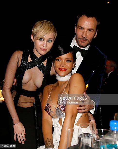 Recording artists Miley Cyrus Rihanna and honoree Tom Ford attend amfAR LA Inspiration Gala honoring Tom Ford at Milk Studios on October 29 2014 in...