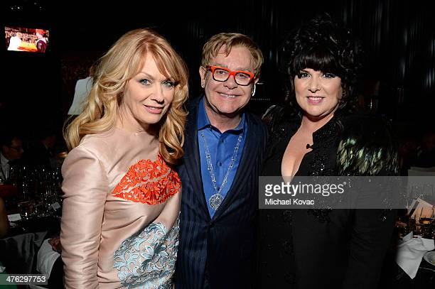 Recording artists Nancy Wilson Sir Elton John and recording artist Ann Wilson attend the 22nd Annual Elton John AIDS Foundation Academy Awards...