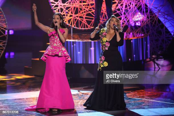 Recording artists Natalia Jimenez and Chiquis Rivera perform onstage during the 2017 Latin American Music Awards at Dolby Theatre on October 26 2017...