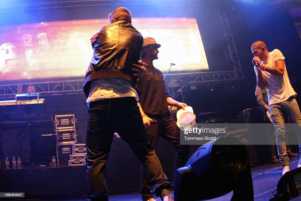 Recording artists Nathan Sykes, Jay McGuiness and Max George of The Wanted perform at the 97.1 Amplify 2013 Concert held at The Hollywood Palladium on April 12, 2013 in Los Angeles, California.