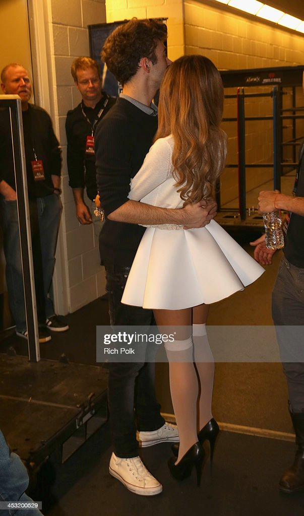 Recording artists Nathan Sykes (L) of The Wanted and Ariana Grande backstage at 106.1 KISS FM's Jingle Ball 2013 American Airlines Center on December 2, 2013 in Dallas, Texas.