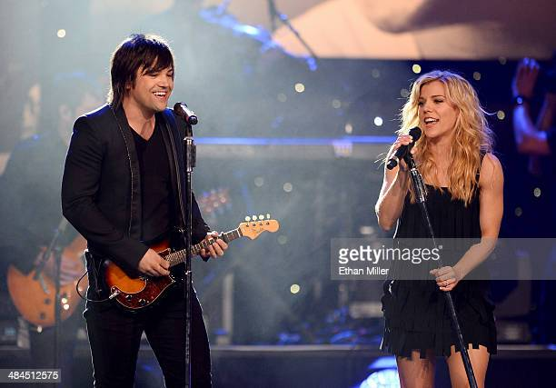 Recording artists Neil Perry and Kimberly Perry of The Band Perry perform onstage during Muhammad Ali's Celebrity Fight Night XX held at the JW...