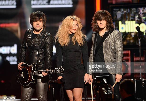Recording artists Neil Perry Kimberly Perry and Reid Perry of The Band Perry perform onstage during the 2013 Billboard Music Awards at the MGM Grand...