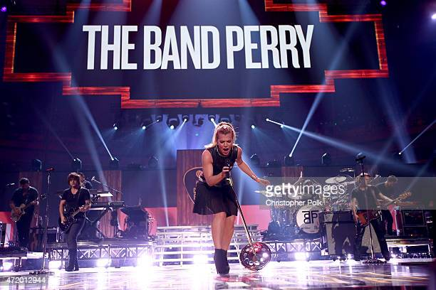 Recording artists Neil Perry Kimberly Perry and Reid Perry of The Band Perry perform onstage during the 2015 iHeartRadio Country Festival at The...