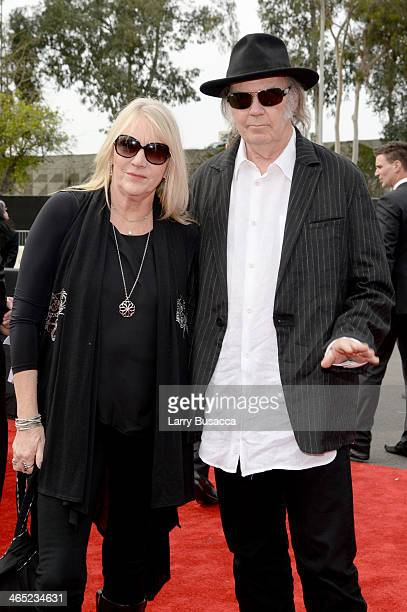 Recording artists Neil Young and Pegi Young attend the 56th GRAMMY Awards at Staples Center on January 26 2014 in Los Angeles California