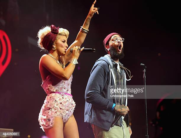 Recording artists Neon Hitch and Travis McCoy perform onstage during KIIS FM's Jingle Ball 2013 at Staples Center on December 6 2013 in Los Angeles CA