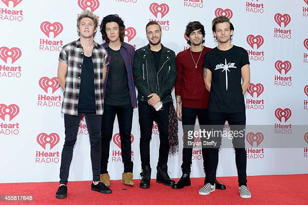 Recording artists Niall Horan, Harry Styles, Liam Payne, Zayn Malik, and Louis Tomlinson of music group One Direction attend the 2014 iHeartRadio...
