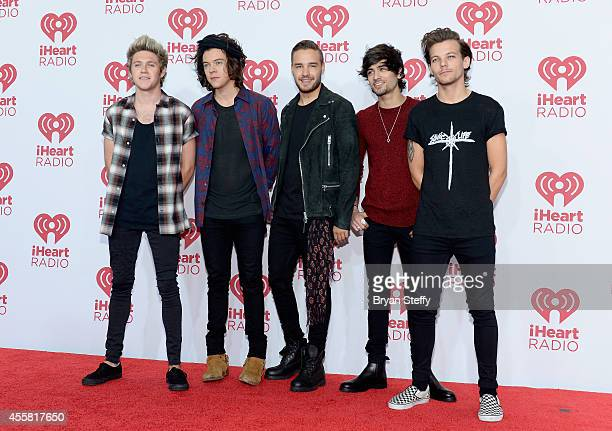 Recording artists Niall Horan Harry Styles Liam Payne Zayn Malik and Louis Tomlinson of music group One Direction attend the 2014 iHeartRadio Music...