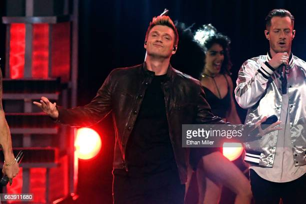 Recording artists Nick Carter of music group Backstreet Boys and Tyler Hubbard of music group Florida Georgia Line perform onstage during the 52nd...