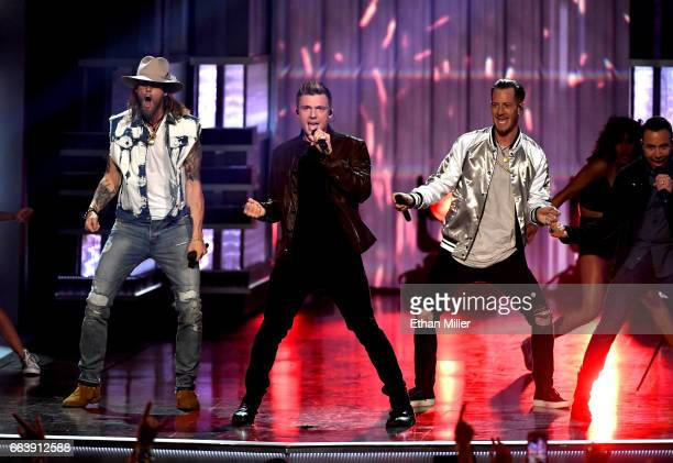 Recording artists Nick Carter of music group Backstreet Boys and Brian Kelley and Tyler Hubbard of music group Florida Georgia Line perform onstage...