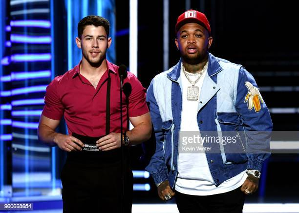 Recording artists Nick Jonas and DJ Mustard speak onstage during the 2018 Billboard Music Awards at MGM Grand Garden Arena on May 20 2018 in Las...