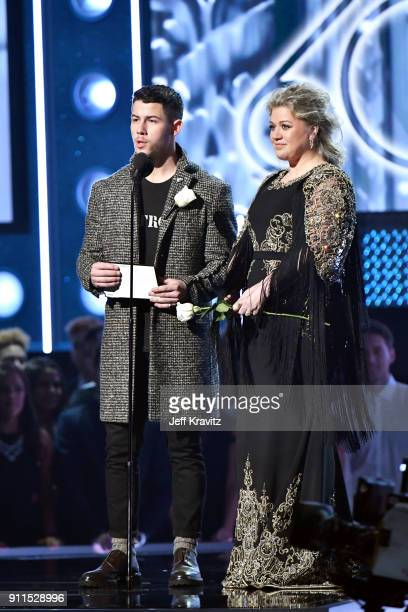 Recording artists Nick Jonas and Kelly Clarkson present an award onstage during the 60th Annual GRAMMY Awards at Madison Square Garden on January 28...