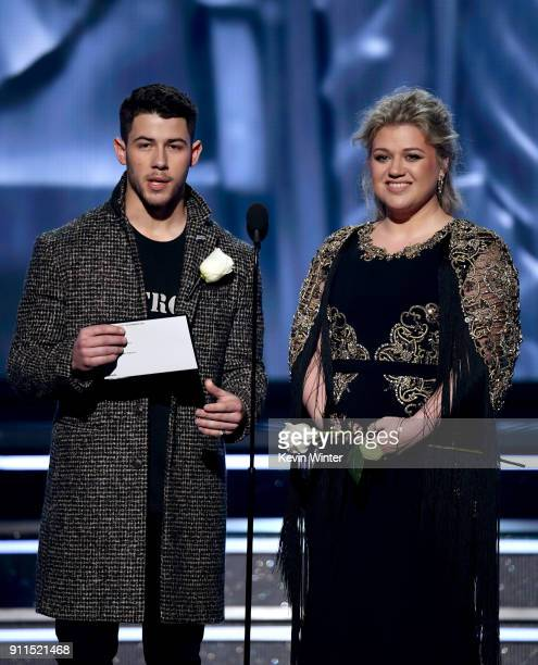 Recording artists Nick Jonas and Kelly Clarkson speak onstage during the 60th Annual GRAMMY Awards at Madison Square Garden on January 28 2018 in New...