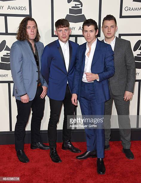 Recording artists Nick O'Malley Jamie Cook Alex Turner and Matt Helders of music group Arctic Monkeys arrive at the 57th Annual GRAMMY Awards at...