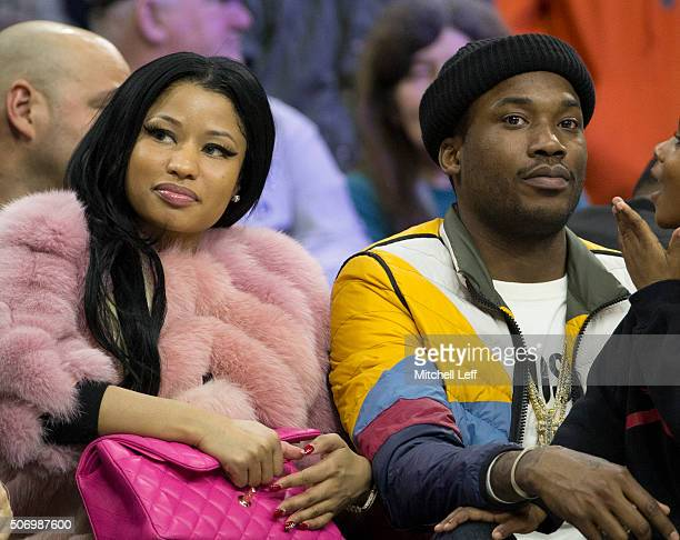 Recording artists Nicki Minaj and Meek Mill look on during the game between the Phoenix Suns and Philadelphia 76ers on January 26 2016 at the Wells...