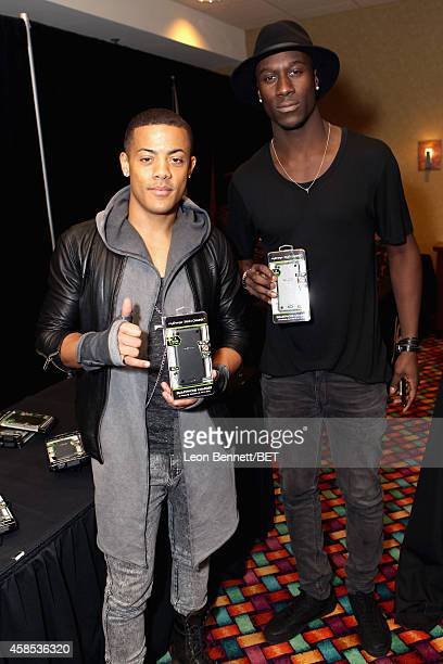 Recording artists Nicola 'Nico' Sereba and Vincent 'Vinz' Dery of Nico Vinz attend day 1 of the 2014 Soul Train Music Awards Gifting Suite at the...