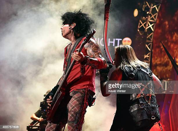 Recording artists Nikki Sixx and Vince Neil of the band Motley Crue perform onstage during the 2014 iHeartRadio Music Festival at the MGM Grand...