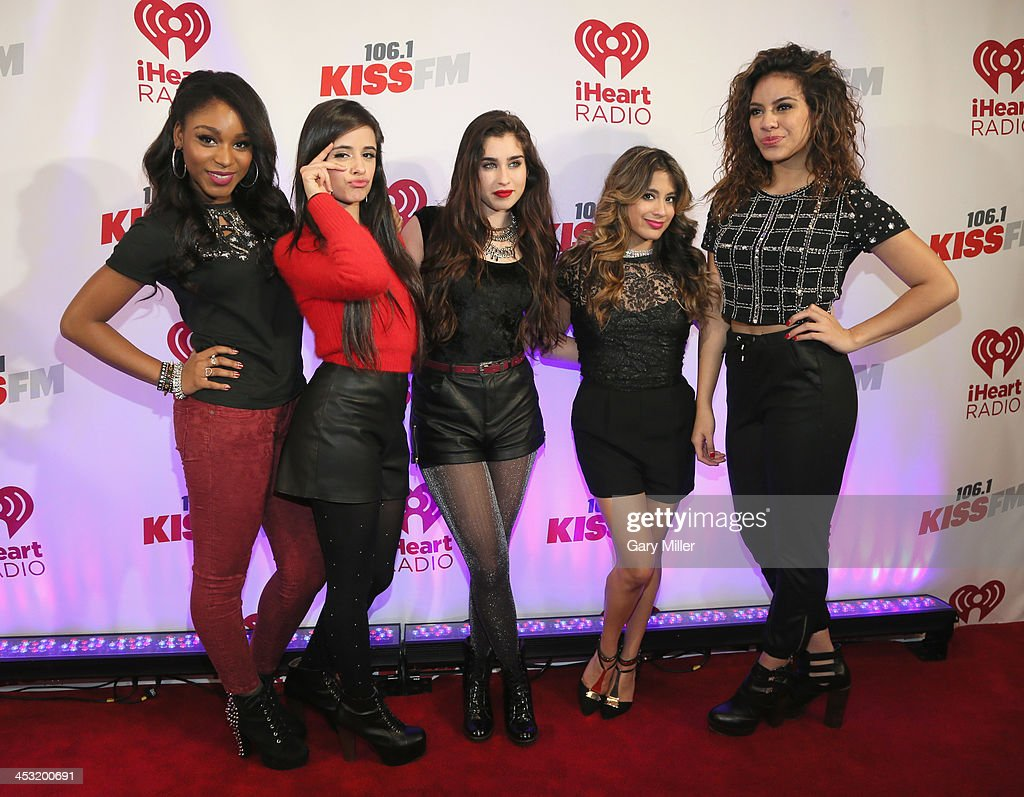 Recording artists Normani Kordei, Camila Cabello, Lauren Jauregui, Ally Brooke and Dinah Jane Hansen of Fifth Harmony pose backstage at 106.1 KISS FM's Jingle Ball 2013 American Airlines Center on December 2, 2013 in Dallas, Texas.