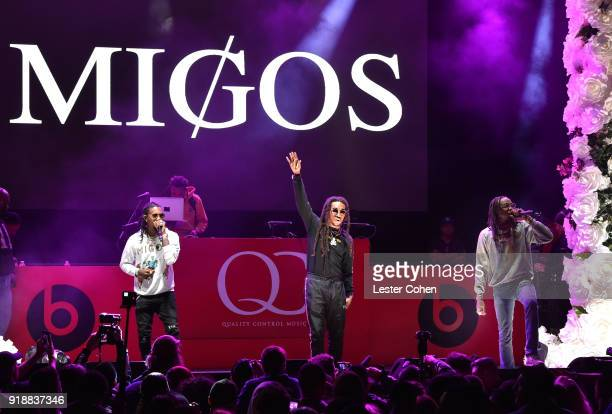 Recording artists Offset Takeoff and Quavo of music group Migos perform onstage during 'AllStar Weekend KickOff Party' at Capitol Records Tower on...