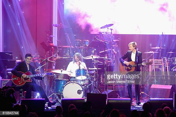 Recording artists Pat Smear Dave Grohl and Beck perform onstage during the 2016 PreGRAMMY Gala and Salute to Industry Icons honoring Irving Azoff at...