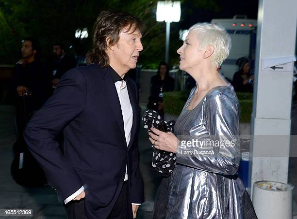 Recording artists Paul McCartney and Annie Lennox of the Eurythmics pose backstage at The Night That Changed America A GRAMMY Salute To The Beatles...