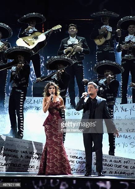 Recording artists Paula Fernandes and Alejandro Sanz peform with Mariachi Sol de Mexico onstage during the 16th Latin GRAMMY Awards at the MGM Grand...
