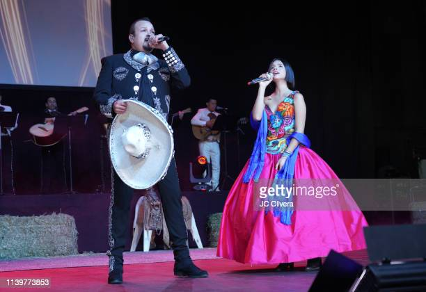 Recording artists Pepe Aguilar and Angela Aguilar perform onstage during Pepe Aguilar and Family 'Jaripeo Sin Fronteras 2019' press conference at Los...
