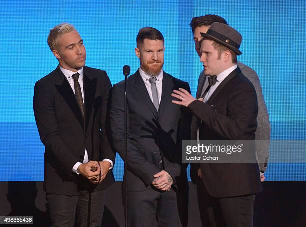 Recording artists Pete Wentz Andy Hurley Joe Trohman and Patrick Stump of Fall Out Boy accept the Favorite Alternative Artist award speak onstage...