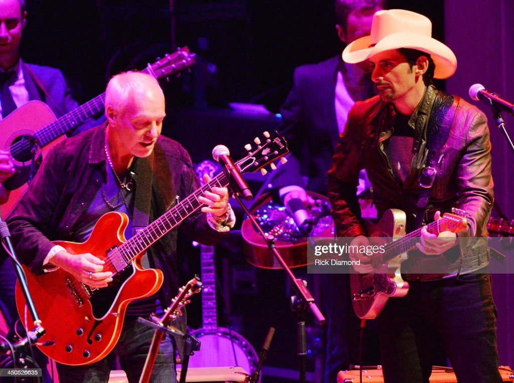Recording Artists Peter Frampton and Brad Paisley perform at the CMA Theater on November 18, 2013 in Nashville, Tennessee. Skaggs was recently announced as the Country Music Hall of Fame and Museum's 2013 Artist-in-Residence. (Photo by Rick Diamond/Getty Images