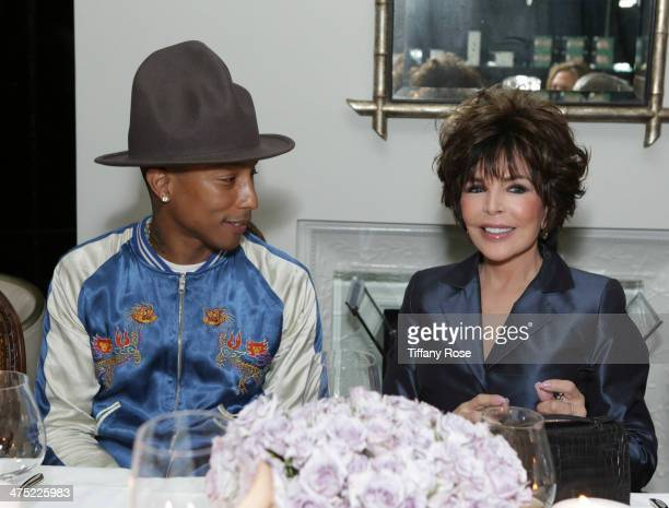 Recording artists Pharrell Williams and Carole Bayer Sager attend VIOLET GREY Honors Elizabeth Taylor At She's So Violet Salon Dinner on February 26...