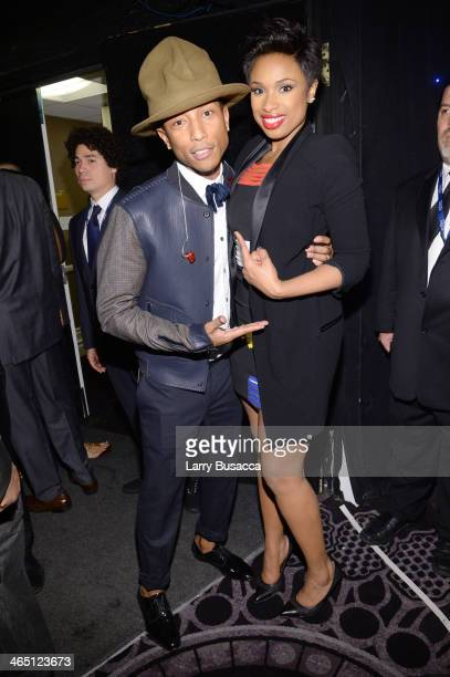 Recording artists Pharrell Williams and Jennifer Hudson attend the 56th annual GRAMMY Awards PreGRAMMY Gala and Salute to Industry Icons honoring...