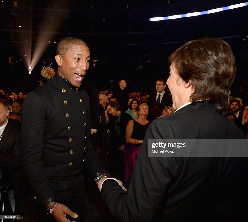 Recording artists Pharrell Williams (L) and Paul McCartney attend The 57th Annual GRAMMY Awards at STAPLES Center on February 8, 2015 in Los Angeles, California.