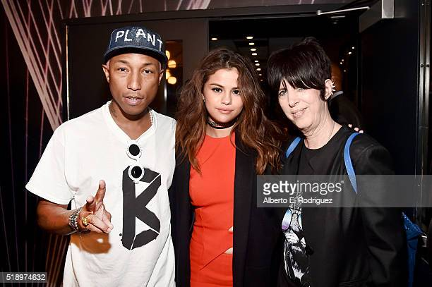 Recording artists Pharrell Williams and Selena Gomez and songwriter Diane Warren pose in the broadcast room during the iHeartRadio Music Awards at...