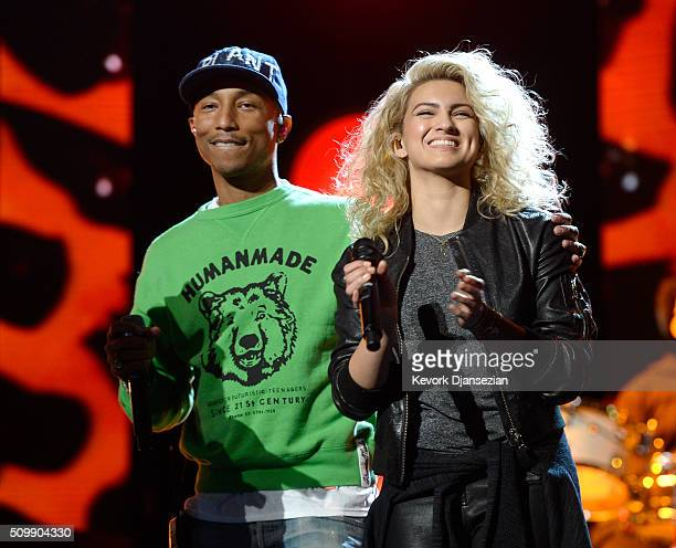 Recording artists Pharrell Williams and Tori Kelly rehearse onstage during the 2016 MusiCares Person Of The Year honoring Lionel Richie at Los...