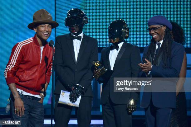 Recording artists Pharrell Williams Daft Punk and Nile Rodgers accept the Best Pop Duo/Group Performance award for 'Get Lucky' onstage during the...