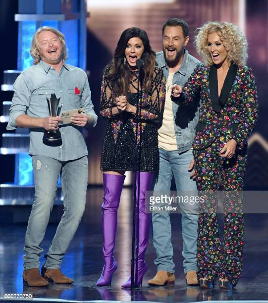 Recording artists Phillip Sweet Karen Fairchild Jimi Westbrook and Kimberly Schlapman of Little Big Town accept the Vocal Group of the Year award...