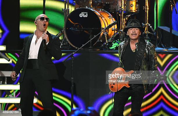 Recording artists Pitbull and Carlos Santana perform during the 15th annual Latin GRAMMY Awards at the MGM Grand Garden Arena on November 20 2014 in...